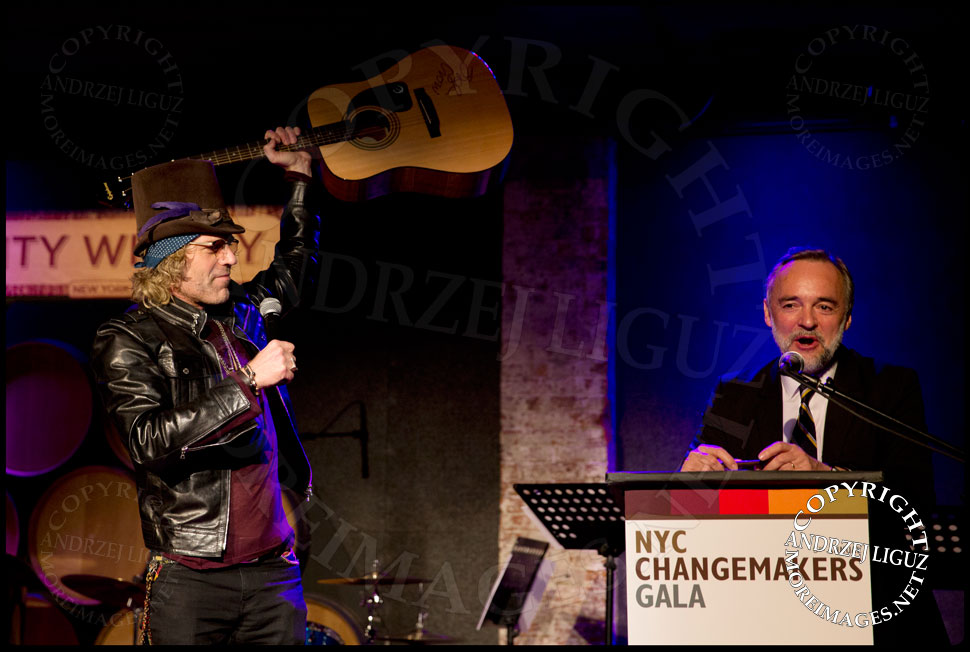 Big Kenny holding aloft Sheryl Crow's guitar for auction at the African Childrens Choir 5th Annual NYC ChangeMakers Gala  © Andrzej Liguz/moreimages.net. Not to be used without permission