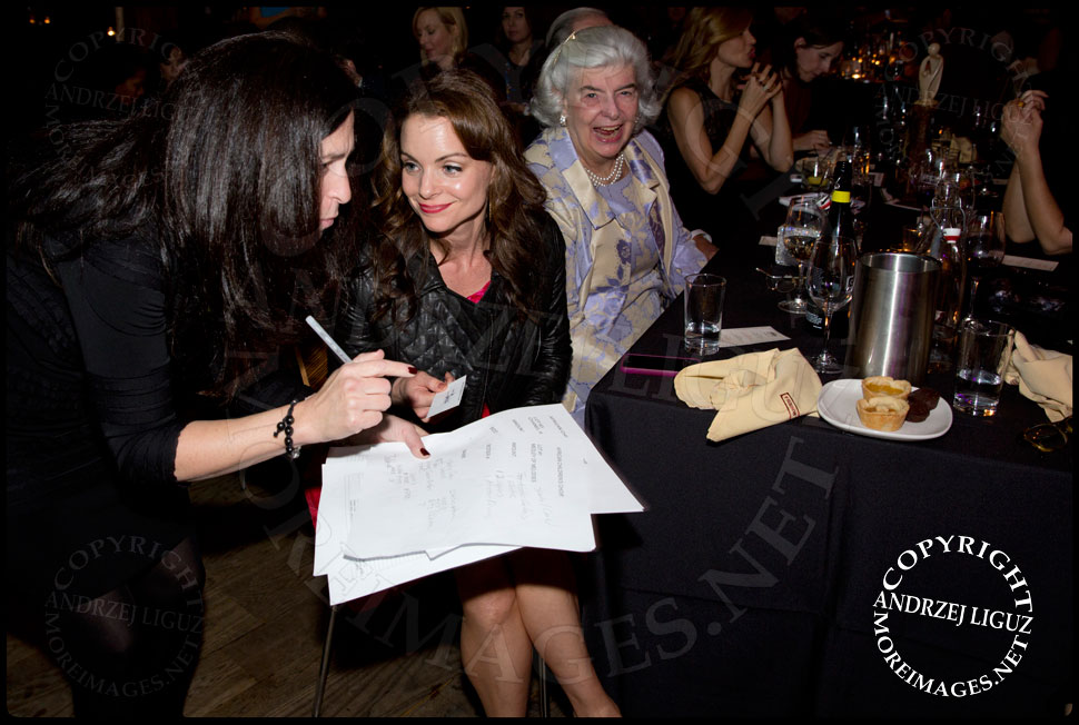 Kimberly Williams-Paisley paying for an item she bought at the auction at the African Childrens Choir 5th Annual NYC ChangeMakers Gala  © Andrzej Liguz/moreimages.net. Not to be used without permission