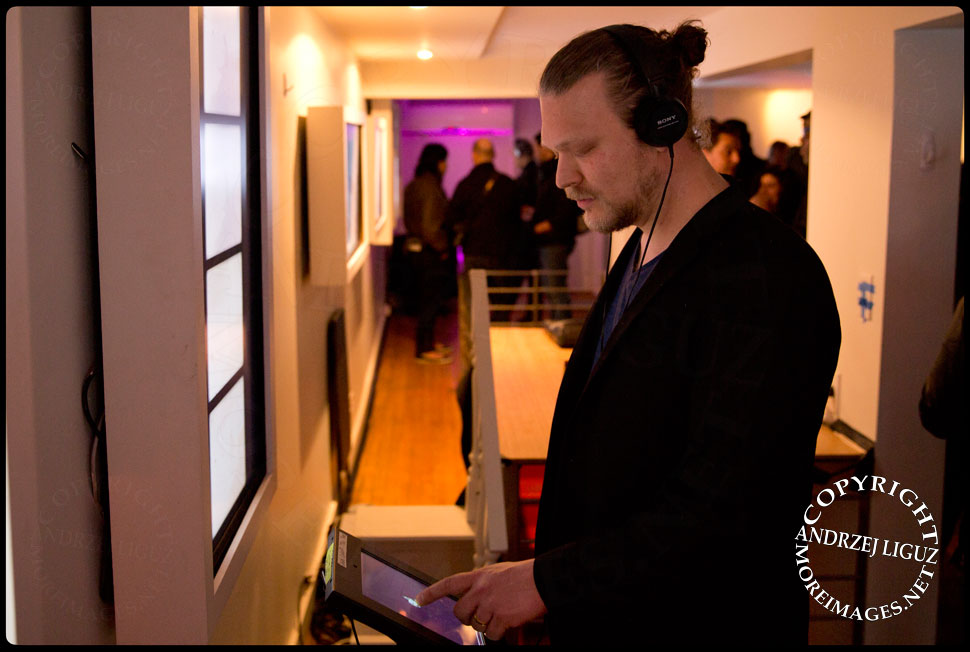 Gralbum Programmer Andrew Beck checks one of the iPads during the launch at Soho Arthouse © Andrzej Liguz/moreimages.net. Not to be used without permission